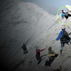 """Stage Four of the Chicken Sacrifice on the top of Mt Bromo - The chicken makes a valiant attempt to """"fly away!"""""""