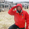 Amidst the guano strewn Gentoo penguin colony in the freezing rain on Petermann Island, Antarctic peninsula