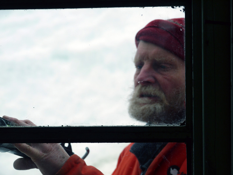A volunteer makes repairs to the UK's base W on Detaille Island, Antarctic peninsula