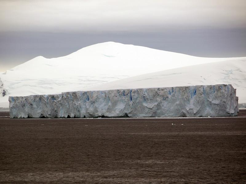 Massive tabular iceberg in the bay at Detaille Island, Antarctic peninsula