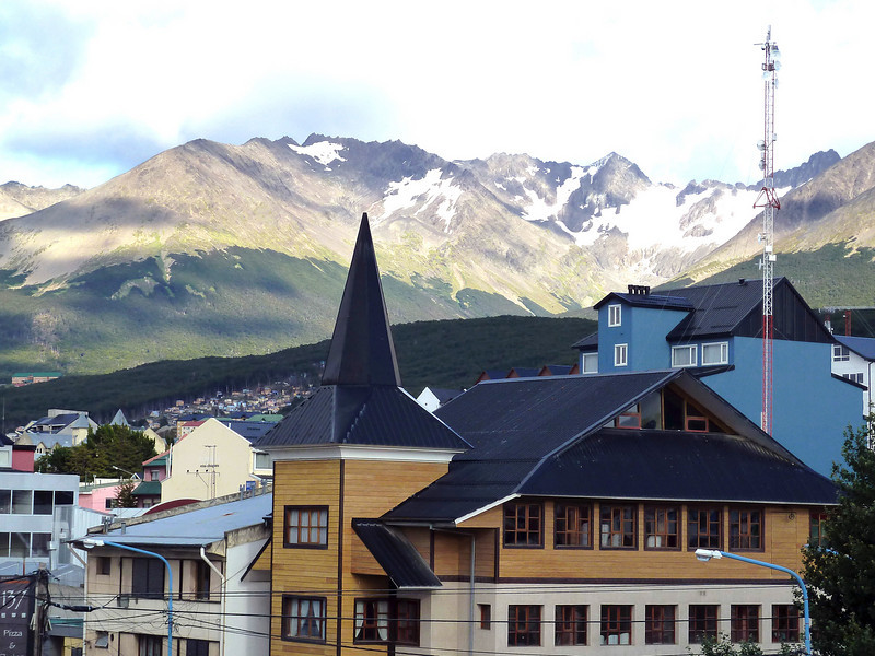 Mountains loom over the town in in Ushuaia, Argentina