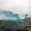 "Natural arch in the ""Icebergs Graveyard"" in the Penola Strait near Booth Island, Antarctic peninsula"