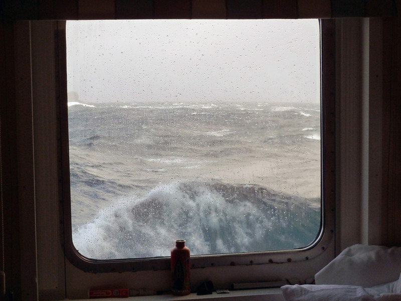 View through the cabin window to stormy seas in the Drake Passage between South America and Antarctica