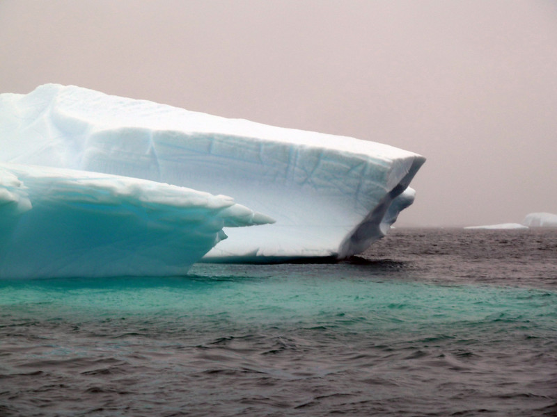 "Unusually large green iceberg in the ""Icebergs Graveyard"" in the Penola Strait near Booth Island, Antarctic peninsula"