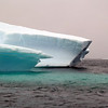 "Unusually large green iceberg in the ""Icebergs Graveyard"" in the Penola Strait near Booth Island, Antarctic peninsula"