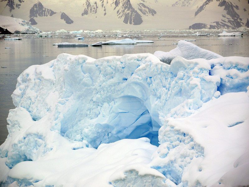 Natural iceberg arch in the Crystal Sound, Antarctic peninsula