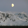 Half moon rising over the mainland in the Gerlache Strait, Antarctic peninsula