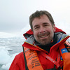 Happy zodiac passenger in the Crystal Sound, Antarctic peninsula