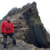 Astride the rim of the caldera at Devil's Window in Deception Island, South Shetland Islands, Antarctica