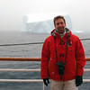 On deck in a snow storm in front of a massive iceberg off the Palmer Coast, Antarctic peninsula