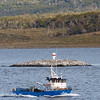 Pilot boat departs the ship in the Beagle Channel near Ushuaia, Argentina