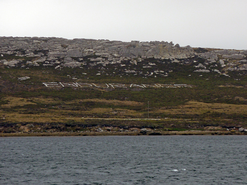 Motivational messages on the hills opposite the harbour in Stanley, Falkland Islands