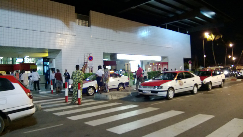 Nighttime arrival at steamy Libreville airport.