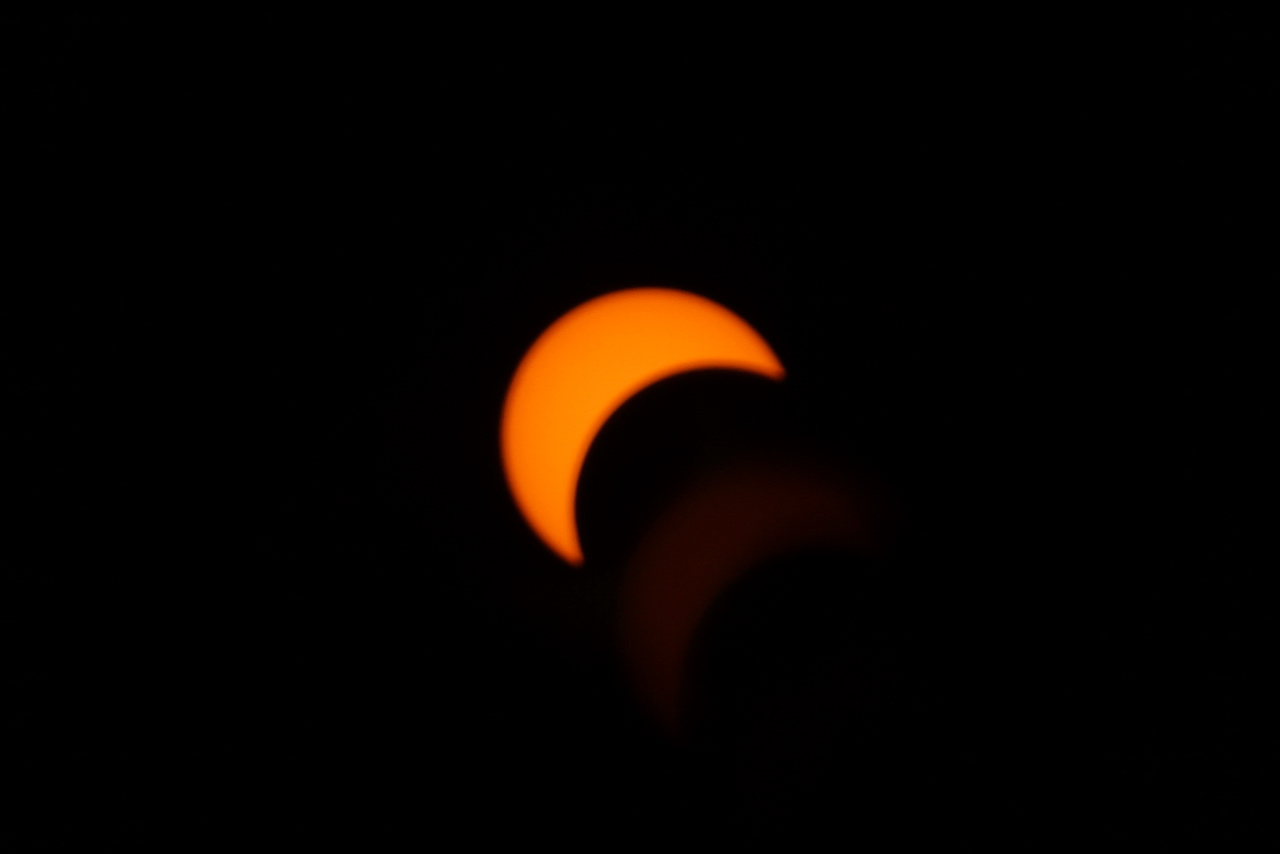 Still a bit indistinct from the cloud cover, the partial eclipse nears the 75% point.