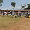 Panorama of the town centre in Bengouie 4 village in rural Gabon, filled with eclipse chasers and locals.