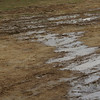 Flash rainstorm leves the village green in a muddy mess and does not portend well for a clear view fo the eclipse.