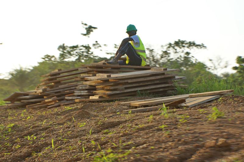 Roadside worker outside Libreville.