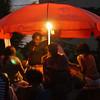 Nighttime market seller in Libreville.