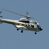 The president & his Parisian wife, handbag dog in tow, arrive by chopper!