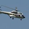 The president & his Parisian wife, handbag dog in tow, arrive by chopper!