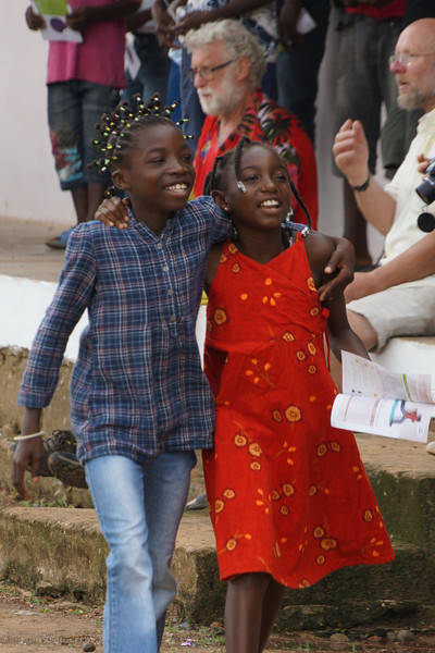 Cheerful girls in the village on eclipse day.