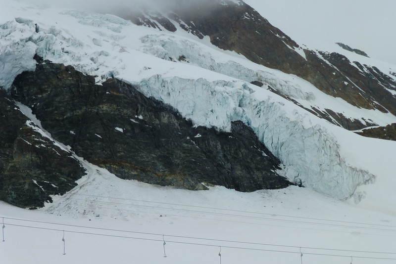 Super spring skiing on the glacier, (peeking out on the side just under the ski run); probably not many years left . . .