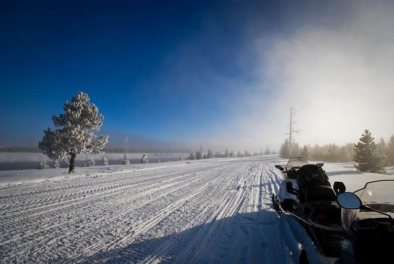 Snowmobiling within Yellowstone National Park<br /> Madison River / Valley area<br /> from West Yellowstone, Montana<br /> © 2010
