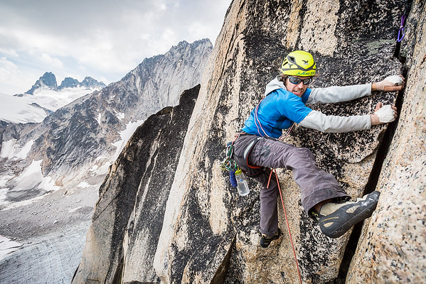 Gian Sebregondi places a foot smear while laying back on our own variation of Ears Between (5.8+) on the Crescent Spire in the Bugaboos of British Columbia, Canada.