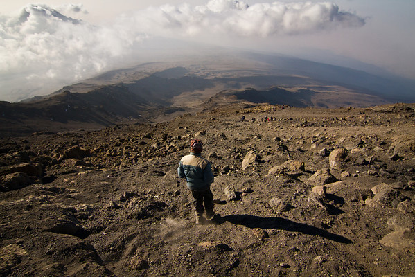 A single guide makes his way down the long scree hill. Barafu lies at the end of this ridge.