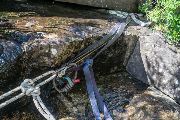 The anchor for the second abseil - a piton, a nut and a wedged knot in a sling.