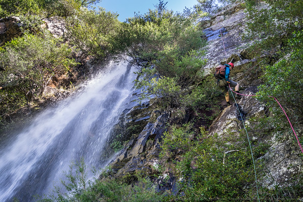 Descending 26m to the ledge next to the big waterfall.
