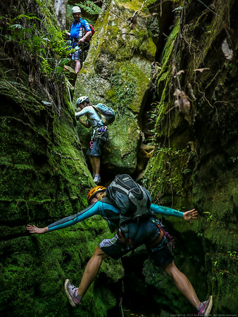 A tricky climb down.  Mel is doing a reverse bridging maneuver.