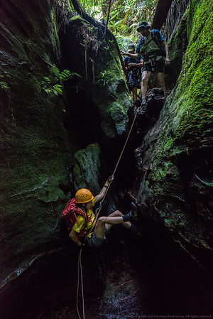 A short awkward abseil or a down climb if you're really keen.