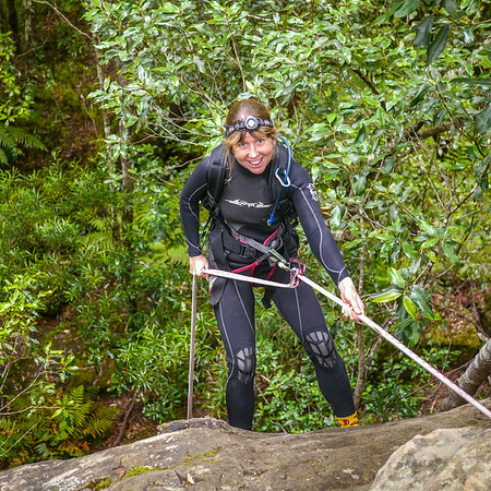 Marese on the 14m abseil into the creek.
