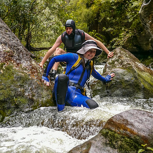 Kim negotiates some rapids in the swollen river.