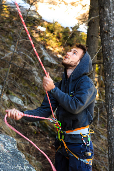 Dillon Key gives Charles Barron a belay who was sport leading _______ (5.10c) on the Cube in the Gallatin National Forest.