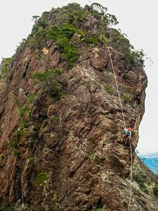 Darren abseils off Leaning Peak.