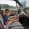Focused on the road, in Morris;'s car