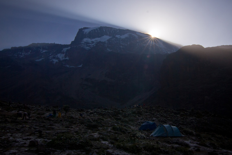 First light spills over the Great Barranco Wall and onto the camp in the early morning.