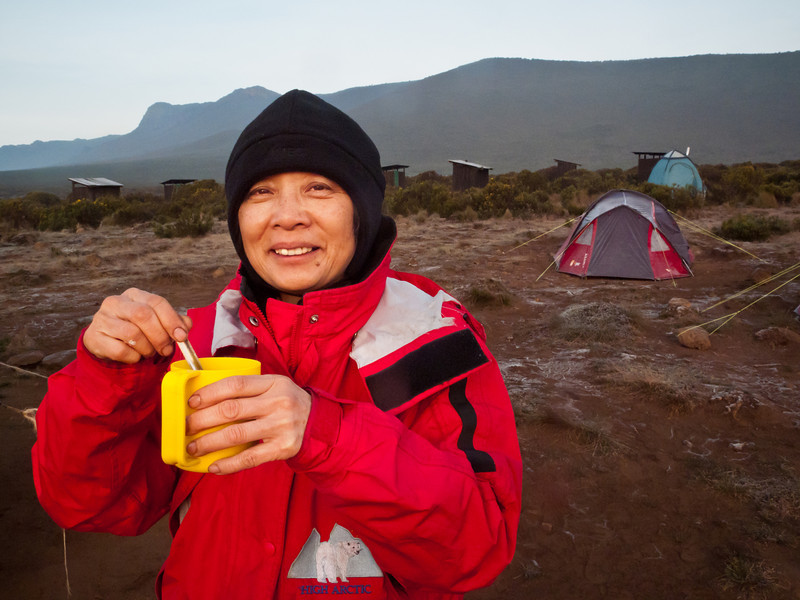Maxine enjoys her morning tea on the mountain. Our tent and porta-potty-tent in the background.
