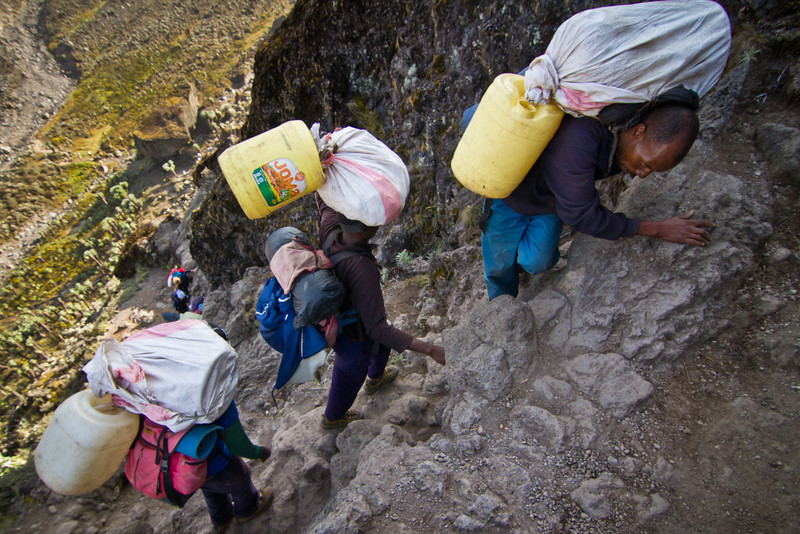 Porters climb the Barranco Wall need both hands, one to hold onto the wall and another to hold onto their cargo. Dropping it here could be extremely costly.