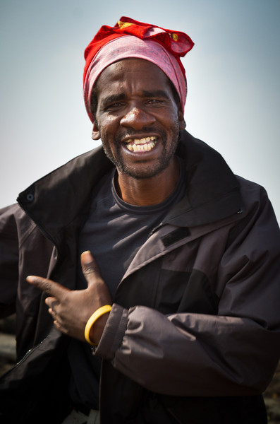 Zawadi grins widely as he sings and dances. He leads the porters from one song to the next. He's been singing these songs for more than 20 years.