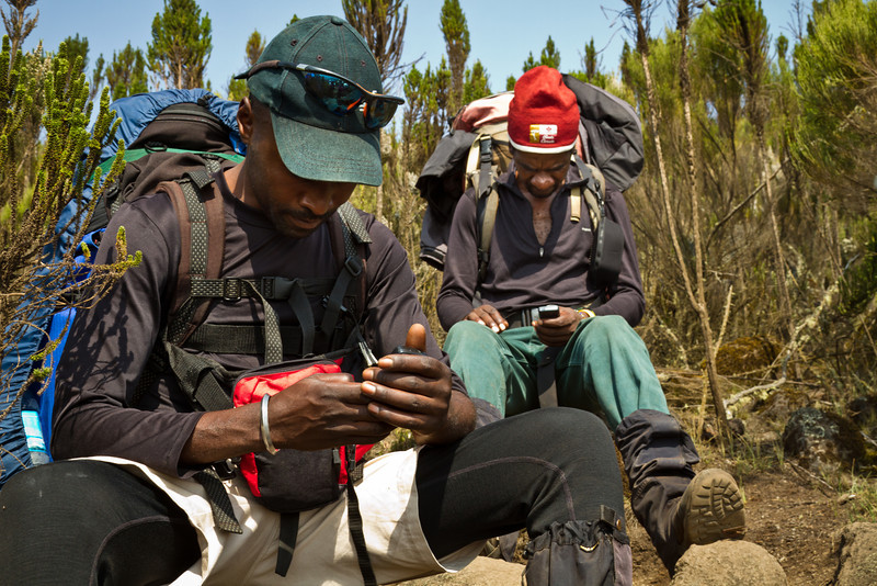The guides know the best spots for catching cellphone signal on the mountain.