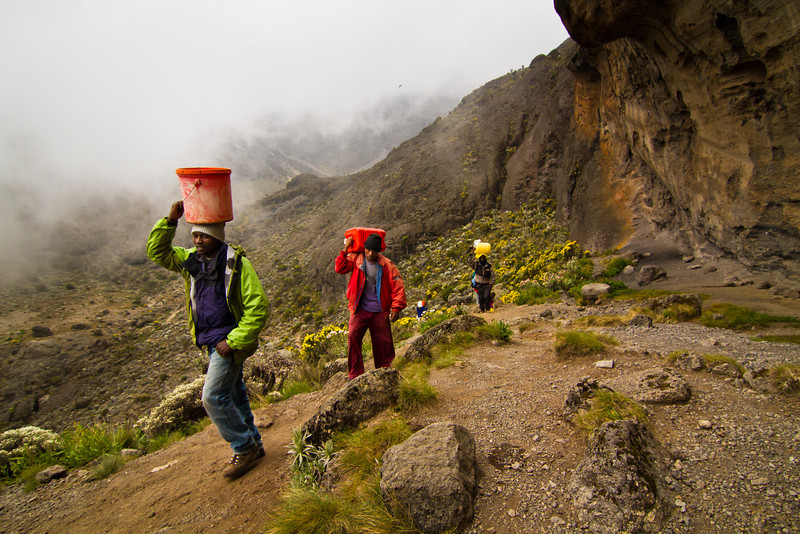 Porters carry several gallons of water to the Karanga Camp from the bottom of Karanga Valley up some 50 m (vertical). This is the last water stop until after the summit.