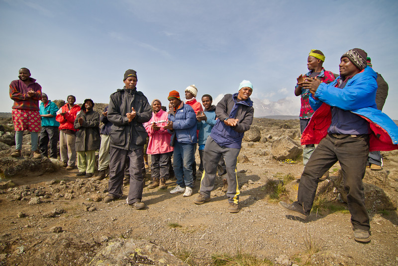 We are warmly welcomed to Shira 2 camp by the Kilimanjaro song, performed by the crew.