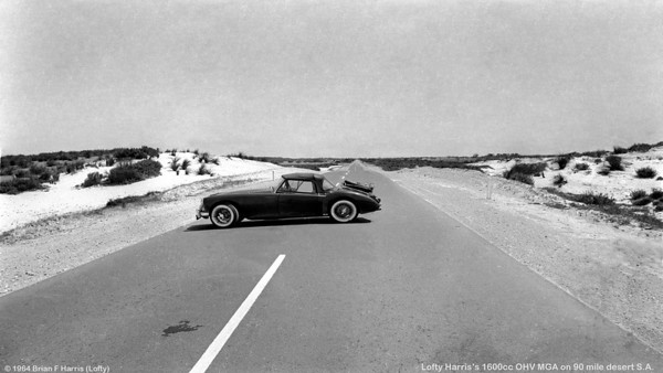 If I find the fool who parked his MGA like that on the highway from Victoria to Adelaide, there will be big trouble. Oh yeah ! I forgot. Photo was taken on a private road and no lives were ever in danger whilst the photograph was being taken. Note the chromed steel chute carrier I got a guy to make for the rear boot (trunk) lid to carry two parachutes.