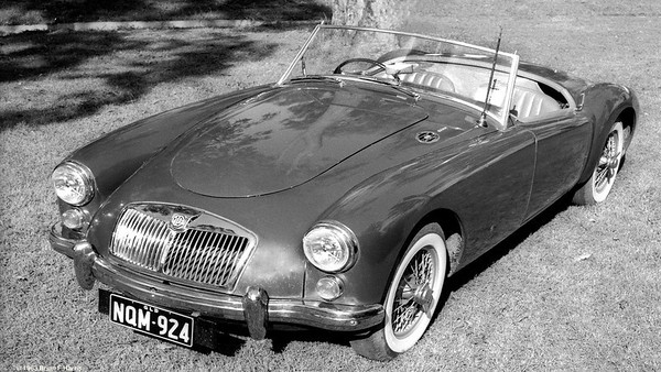 Lofty Harris bought the used MGA 1600 from Geary Motors just before Stones Corner (Brisbane) going south. Sold it back to them after about four great years of fun use and no (I mean none) repairs. Drove it in Qld, NSW, ACT, Vic and SA. Still miss those wire wheels and one hit with the copper hammer spinners. Hubs have fine British engineered splines. Lofty Harris got a chromed steel luggage rack made up for the rear boot lid to carry two parachutes when going jumping. Trunk held minimum weekend clothes & kit.
