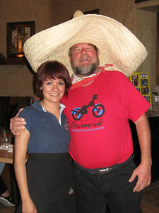 Mike and the waitress.  He had to wear the party hat.