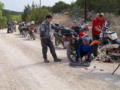 How many riders does it take to fix a flat?  12.  Two to change the tube while the other 10 watch and take pictures.