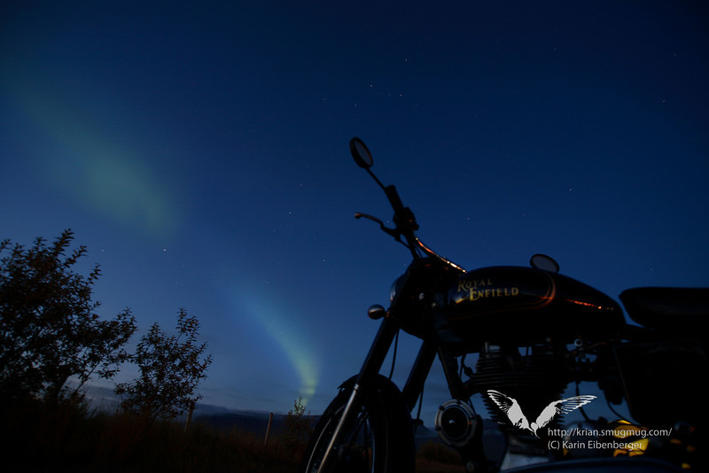 A Royal Enfield under northern lights.